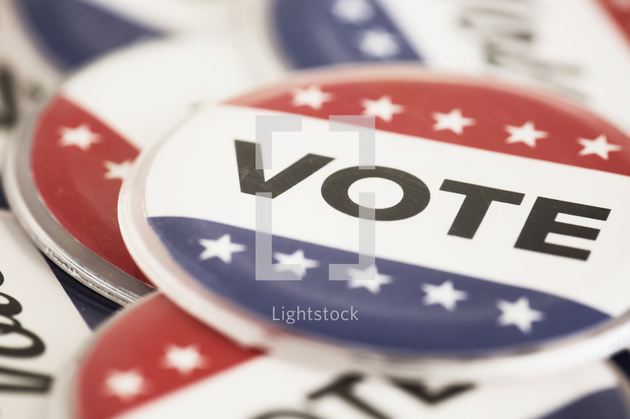 """Red white and blue buttons reading, """"Vote."""""""