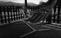 a man resting in a hammock