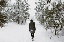 a woman walking through the snow