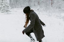 a woman dredging through thick snow