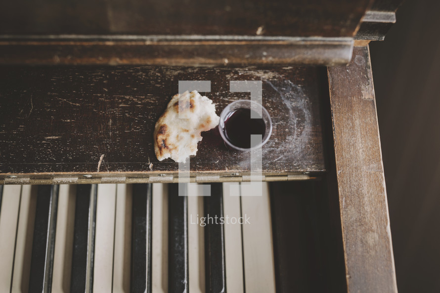 wine and bread on piano for communion