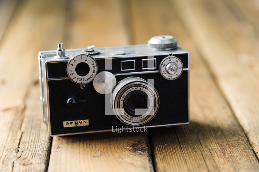 old camera on a wood floor