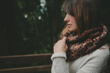 a woman in an animal print scarf