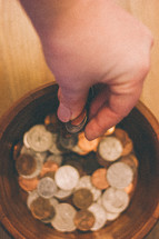 placing coins in a jar