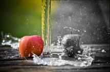 water over apples