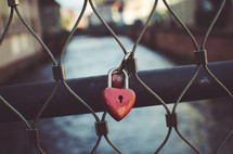 heart lock on a fence