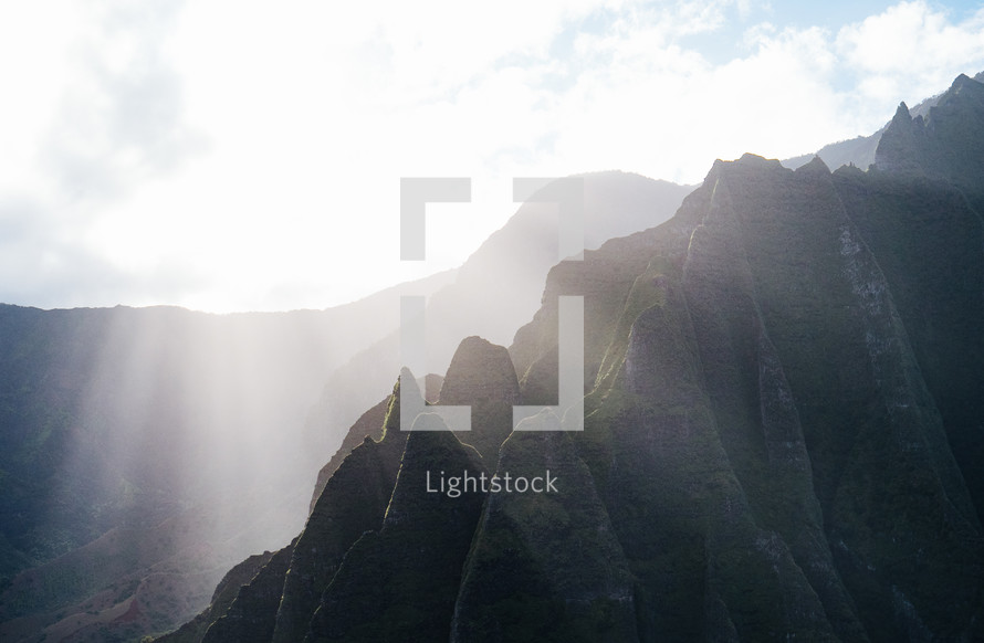 sunbeams on a rugged cliffs on a mountainous island landscape