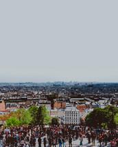 People gathered around watching a paris Skyline