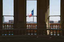 view of the Texas flag from the state capitol building in Austin