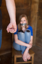 young woman duct taped near her abuser