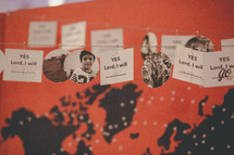 World peace pledge card strung on a line.