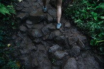 woman hiking through a jungle