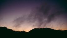 mountain and a purple sky