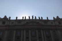 statues on a roof in the vatican