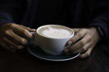 a girl holding a latte at a Bible study