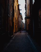 man walking in a narrow alley