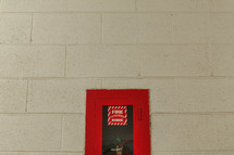 fire extinguisher in a wall cabinet