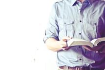 man reading a Bible