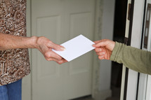 giving an envelope to a neighbor