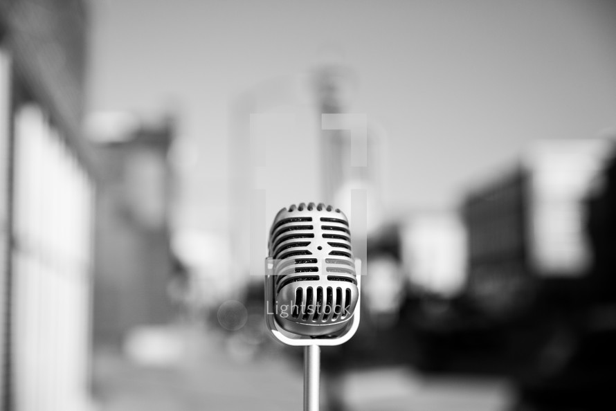 Retro microphone in the middle of a city.
