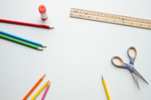 colored pencils, scissors, ruller, glue stick, and pencil