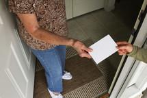giving an envelope to a neighbor