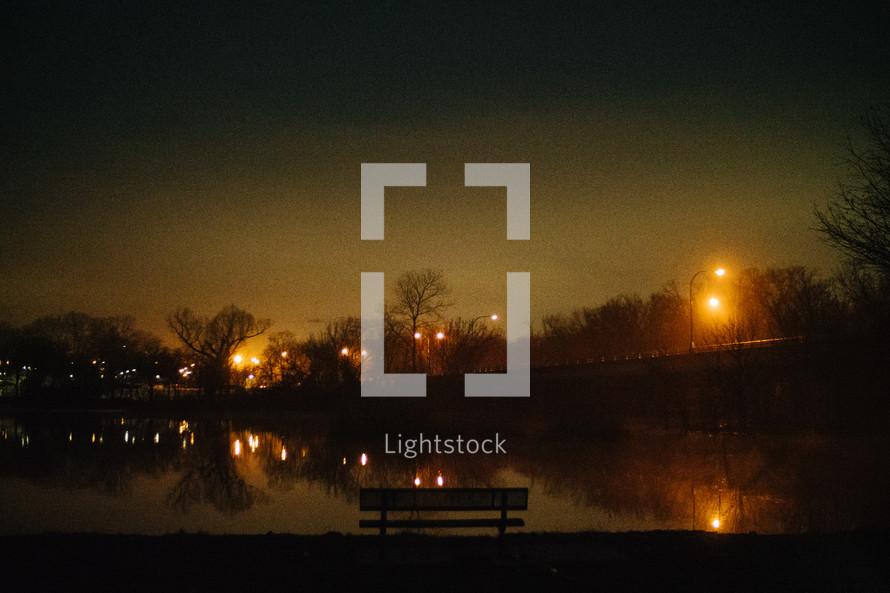 lights around a pond at night