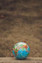 globe on concrete