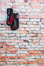 boxing gloves and a brick wall