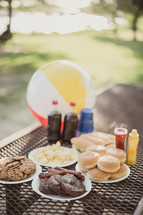 food on a picnic table outdoors