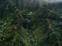 green rugged cliffs on a mountainous island landscape