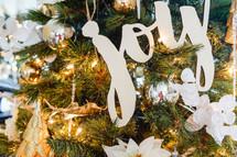 joy ornament on a Christmas tree