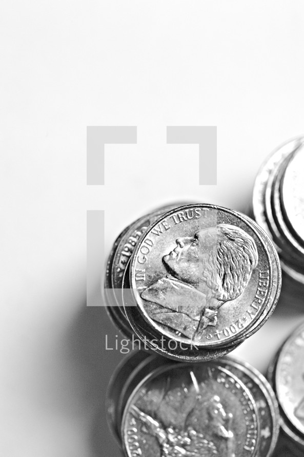 Stacks of nickels isolated on white