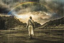 Jesus walking through a rainstorm toward a rainbow.