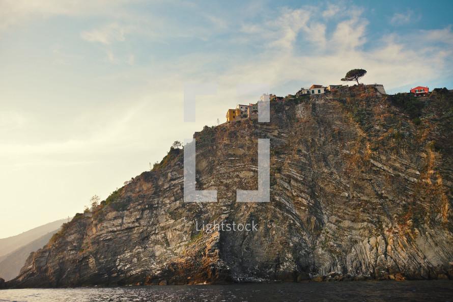 village on top of coastal peak overlooking the ocean