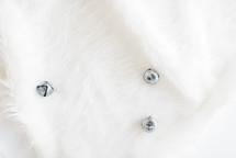 silver bells on white fur
