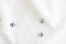 silver bells on white fur