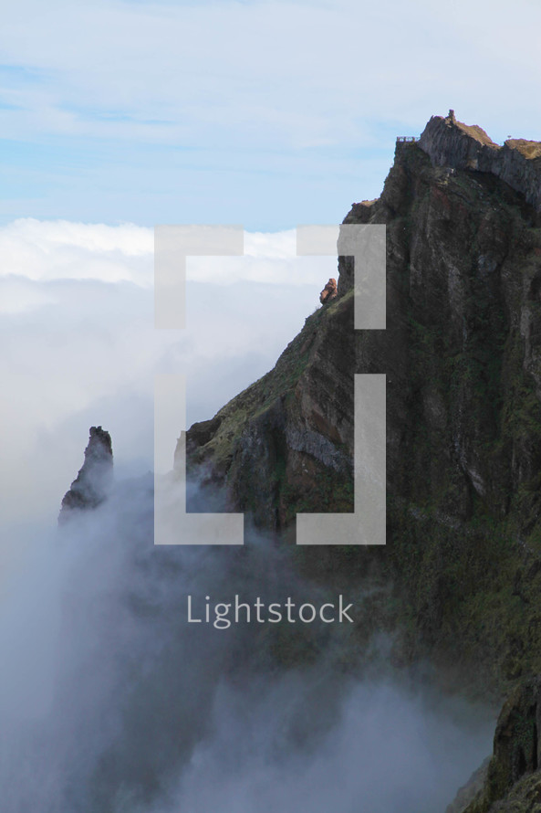 Mountain cliff and fog with view tower