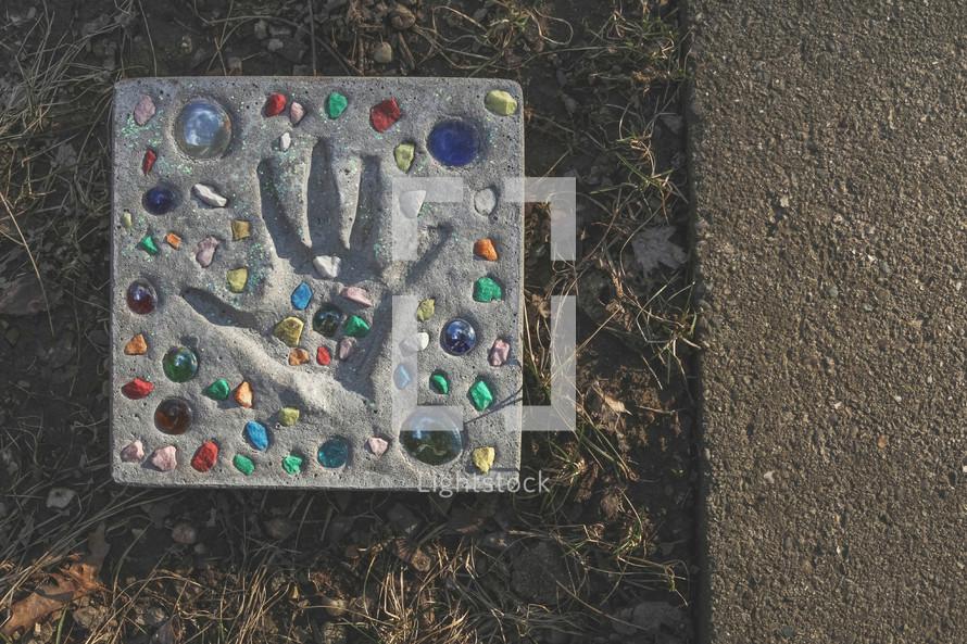 child's handprint in concrete craft