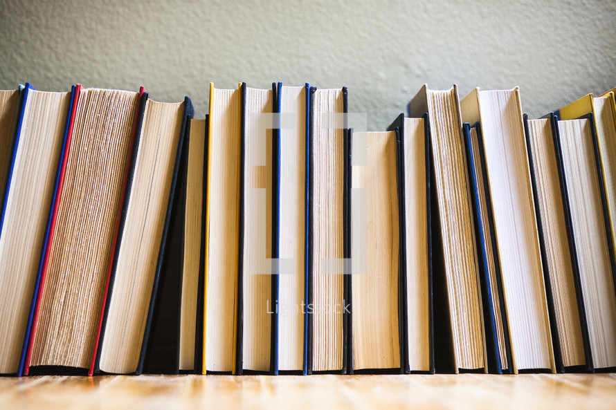 row of books on the floor