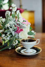 tea cup and flower arrangement