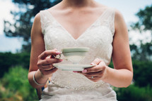 a bride holding a tea cup