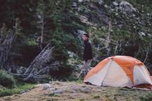 man standing near a tent