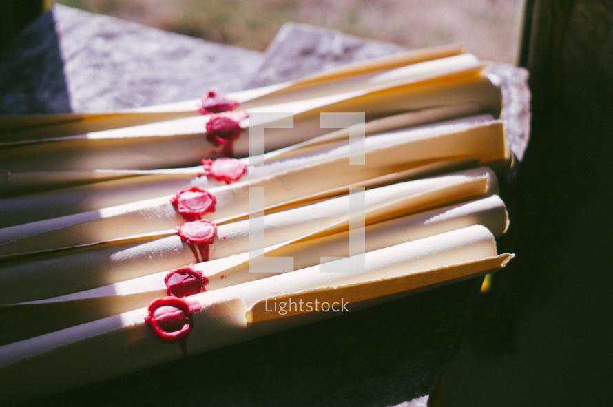 scrolls with wax seals