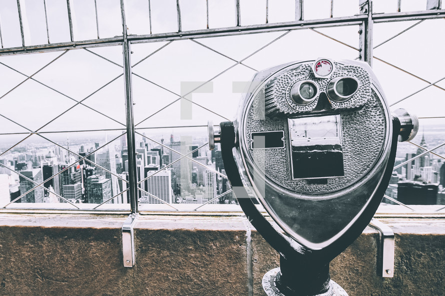 viewfinder scope on a city building rooftop