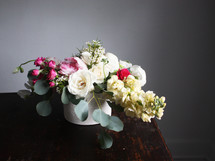 flower arrangement on a wood table