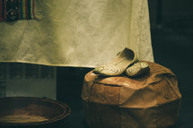 wooden bowl and shoes on a stool