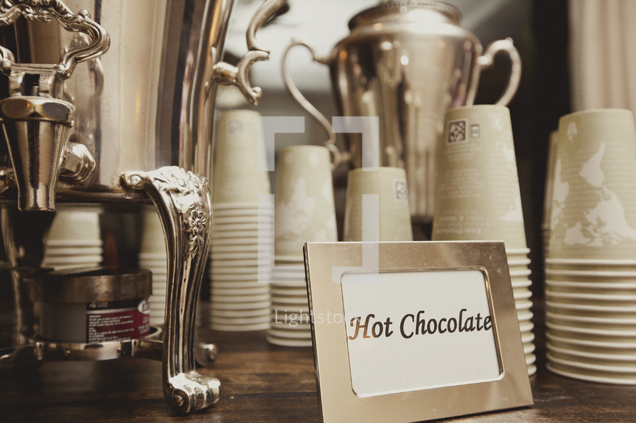 A table set up with hot chocolate and cups