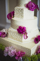 Wedding cake with purple and pink flowers
