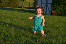 Happy little girl in yard